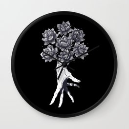 Hand with lotuses on black Wall Clock