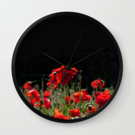 Red Poppies in bright sunlight Wall Clock