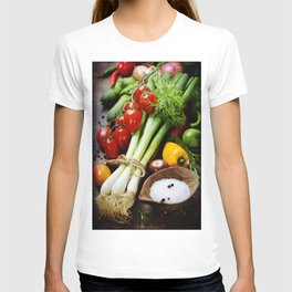 fresh spring onions and vegetables on a wooden board T-shirt