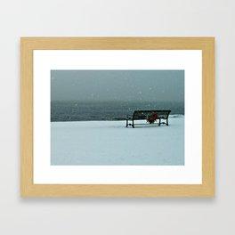 Lone Bench in winter Framed Art Print