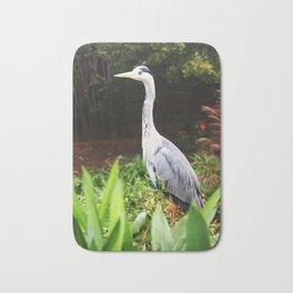 Heron bird in grove Bath Mat