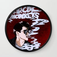 arctic monkeys Wall Clocks featuring Arctic Monkeys- Up in Smoke by Tune In Apparel