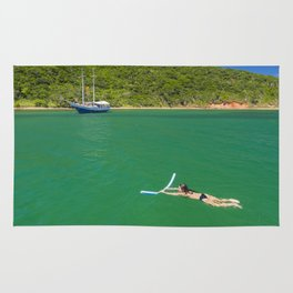 Woman swimming in green waters in Brazil Rug