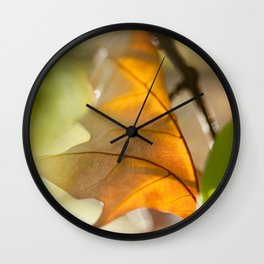 Winter leaf in the wind Wall Clock