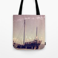pirate ship Tote Bags featuring Pirate Ship by Apples and Spindles
