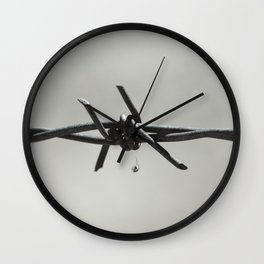 Spider on Barbed Wire in Black and White Wall Clock
