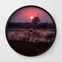 Botswana Africa Sunset over a Marsh Wall Clock