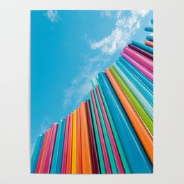 Colorful Rainbow Pipes Against Blue Sky Poster