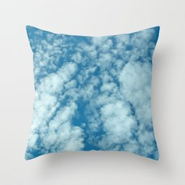 Fluffy clouds in a blue sky Throw Pillow