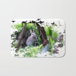 Rabbit hiding in long grass Bath Mat