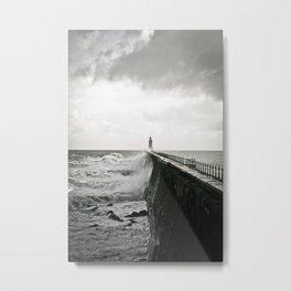 Waves break against an English pier Metal Print