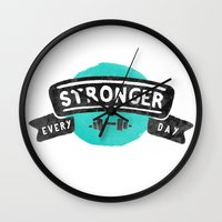 crossfit Wall Clocks featuring Stronger Every Day (dumbbell) by Lionheart Art