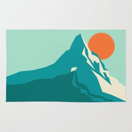 As the sun rises over the peak Rug