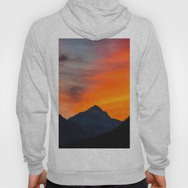 Stunning vibrant sunset behind mountain Hoody