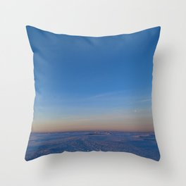 Dawn in the blue cloudless sky over the white snow ice desert of the frozen sea Throw Pillow