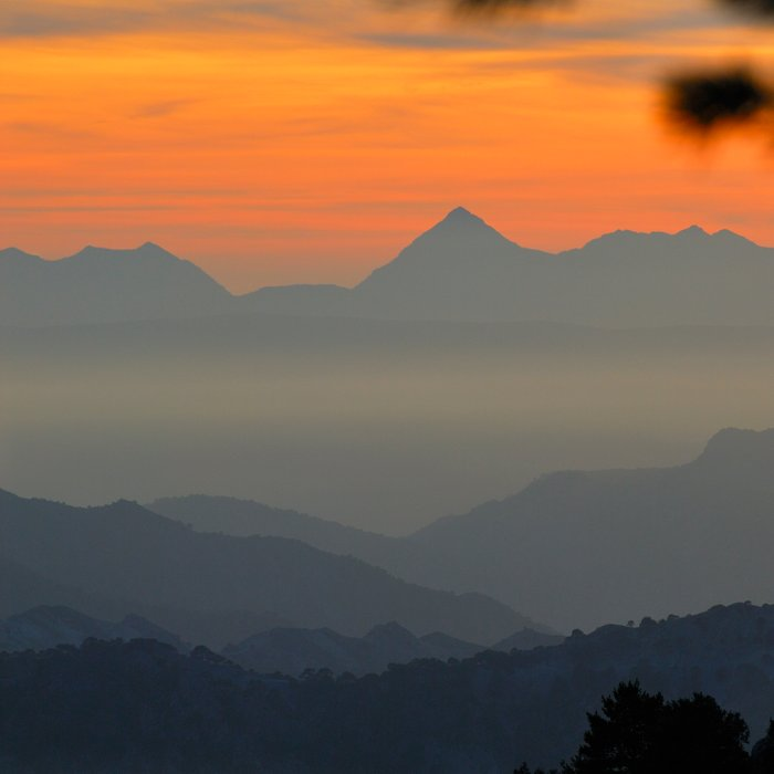 """""""Sunset at the mountains II"""" Comforters"""