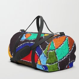 A carpet with an abstract pattern made by hands. Duffle Bag