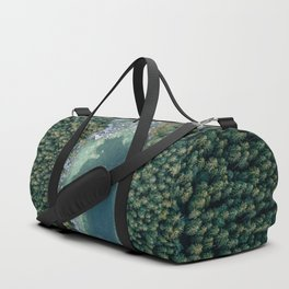Aerial photo of a magic lake hidden inside a pine forest Duffle Bag