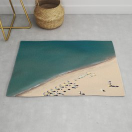 Aerial view of beach with umbrellas and beds in Greece  Rug