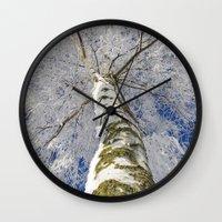 john snow Wall Clocks featuring Snow worlds by Tanja Riedel