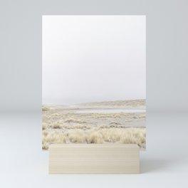Windswept beach grass on dunes and lake - fine art photo print shot in The Netherlands Mini Art Print