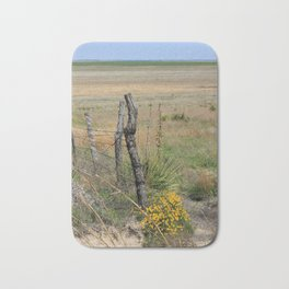 Wooden Fence Corner Post with Yellow wild flowers Bath Mat