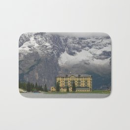 A House in Front of the Snowy Mountains Bath Mat