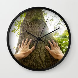 Personal perspective of a man hugging a tree Wall Clock