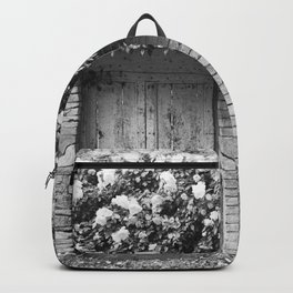 Old Italian wall overgrown with roses Backpack