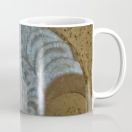 Ammonite in fossilized river bed Coffee Mug