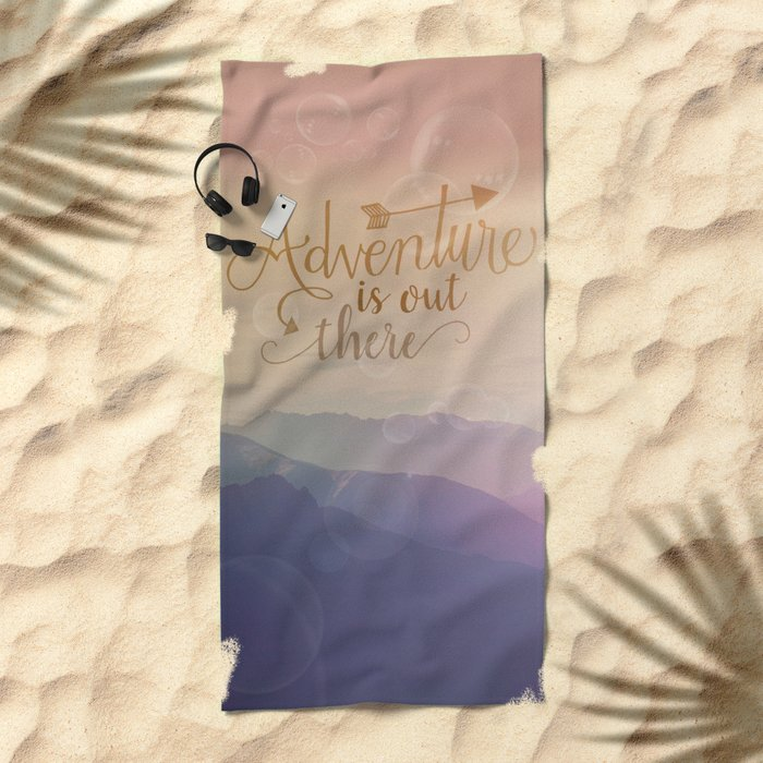 Adventure is out there! View over hills Beach Towel