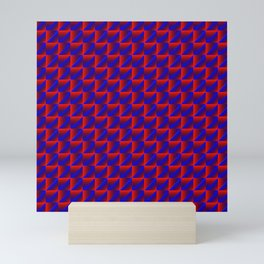 Chaotic pattern of blue rhombuses and red pyramids in a zigzag. Mini Art Print