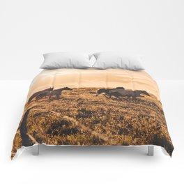 wild horses at dusk Comforters