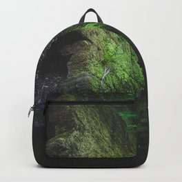 Green mossy rock with reflection in water Backpack