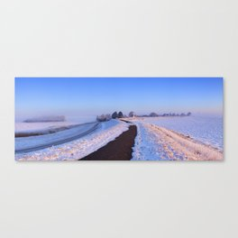 II - Lake and dike at sunrise in winter in The Netherlands Canvas Print