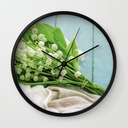 a bunch of lily of the valley Wall Clock