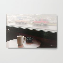 A cup of coffee on a wooden table with ashtray, near a window, retro, film style. Metal Print