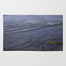 Lone Surfer Girl Rug