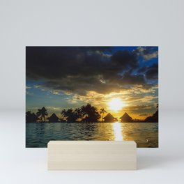 Silhouettes Of Palm Trees And Huts At Sunset in French Polynesia Mini Art Print