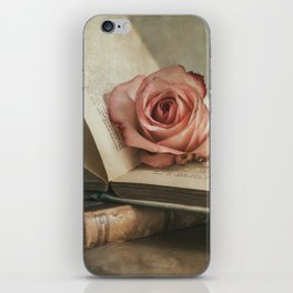Still life with pink rose and old books iPhone Skin
