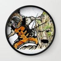 rocket raccoon Wall Clocks featuring Rocket Raccoon and Groot by artbyteesa