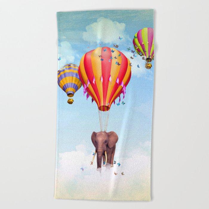 Elephant flying Beach Towel