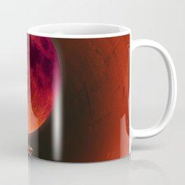 Holding the Blood Moon Coffee Mug