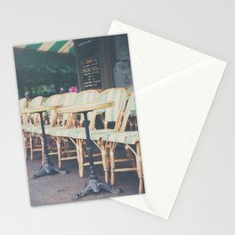 tables & chairs outside of a Paris cafe Stationery Cards