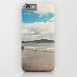 A row boat abandoned on the beach at Lyme Regis, England iPhone Case