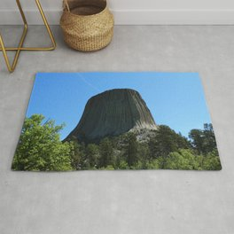 Devils Tower Rising Into The Sky Rug