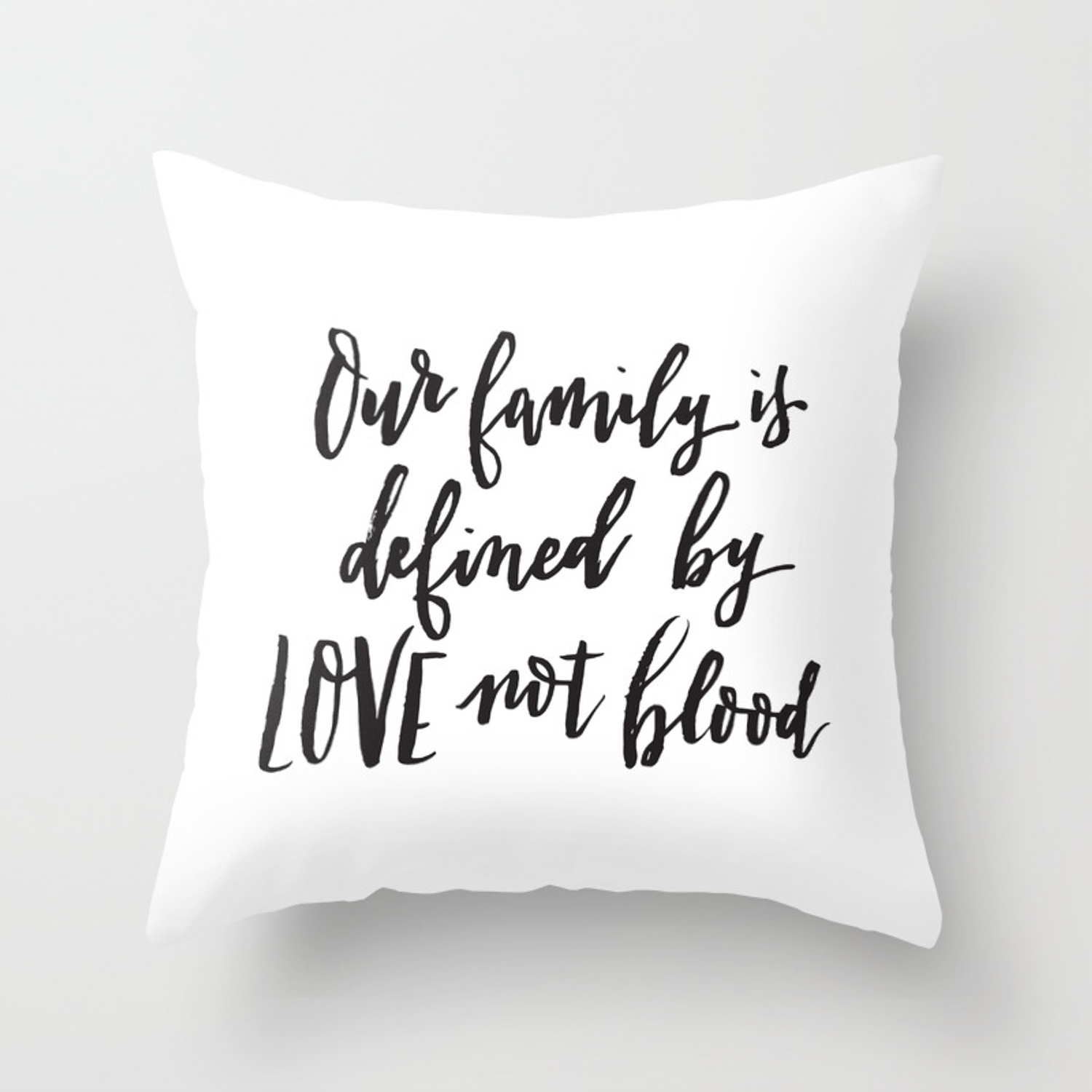 Our family is defined by LOVE not blood - Hand lettered inspirational quote  Throw Pillow