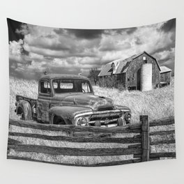 Black and White of Rusted International Harvester Pickup Truck behind wooden fence with Red Barn in Wall Tapestry