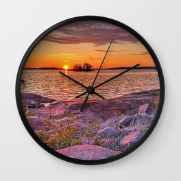Sunset colors on the cliff Wall Clock