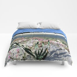 pink flowers on the white beach Comforters